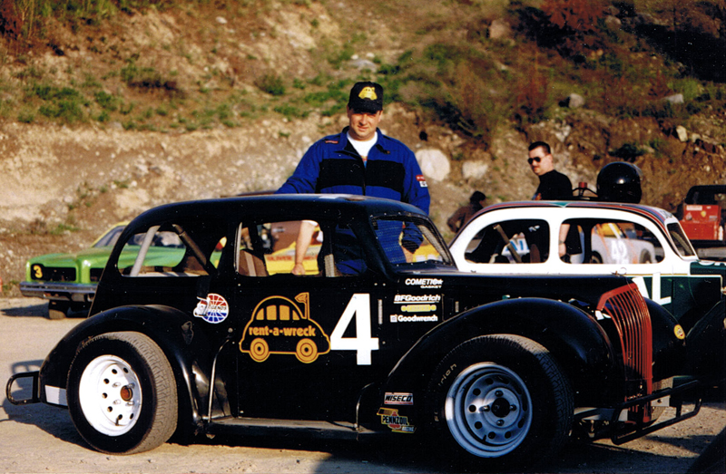 Darren Turner in the Penticton Speedway pits with the Rent a Wreck sponsored Legends Series race car